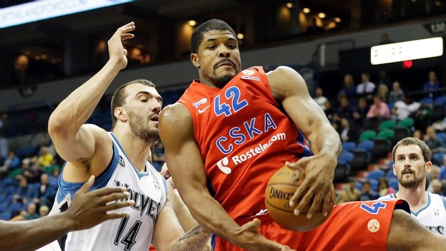 CSKA Moscow's Kyle Hines, right, beats Minnesota Timberwolves' Nikola Pekovic, of Montenegro, to the rebound in the first quarter of a preseason NBA basketball game, Monday, Oct. 7, 2013, in Minneapolis. (AP Photo/Jim Mone)