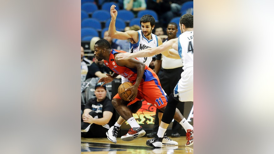 CSKA Moscow's Jeremy Pargo, left, drives between Minnesota Timberwolves Ricky Rubio, center, of Spain, and Kevin Love, right, in the first quarter of a preseason NBA basketball game, Monday, Oct. 7, 2013, in Minneapolis. (AP Photo/Jim Mone)