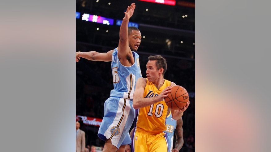 Los Angeles Lakers guard Steve Nash (10) looks to make a pass with Denver Nuggets forward Anthony Randolph defending during an NBA preseason basketball game Sunday, Oct. 6, 2013 in Los Angeles. (AP Photo/Alex Gallardo)