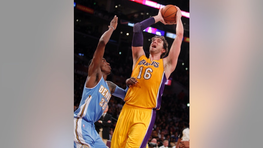 Los Angeles Lakers forward Pau Gasol (16), of Spain, takes a shot with Denver Nuggets forward Quincy Miller defending in the second quarter during an NBA preseason basketball game Sunday, Oct. 6, 2013 in Los Angeles. (AP Photo/Alex Gallardo)