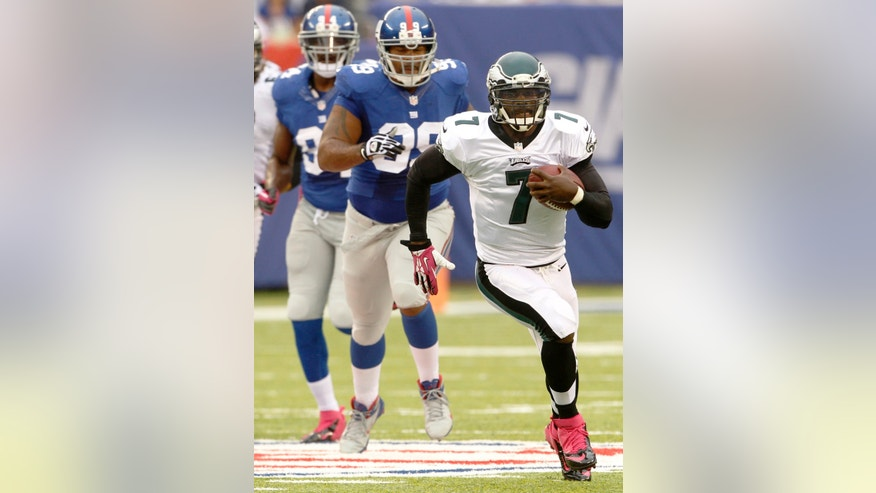 Eagles' Michael Vick runs for a long gain in first half NFL football action between the Philadelphia Eagles at New York Giants at Met Life Stadium on Sunday, Oct. 6,  2013, in Philadelphia. (AP Photo/Philadelphia Inquirer, Ron Cortes)  (AP Photo/The Philadelphia Inquirer, Ron  Cortes)  PHIX OUT; TV OUT; MAGS OUT; NEWARK OUT