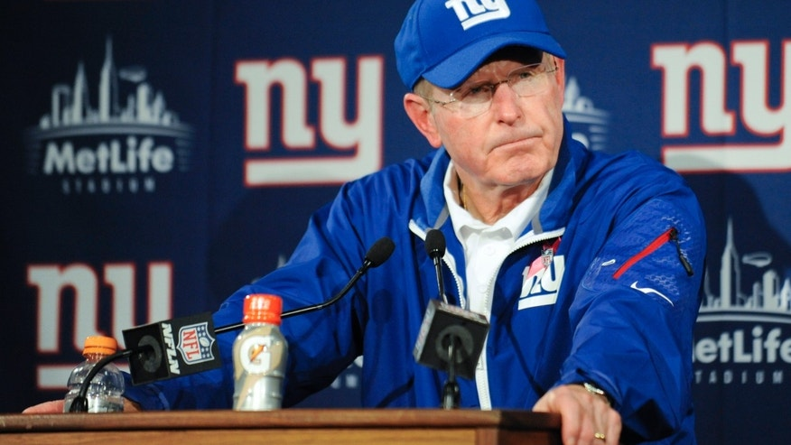 New York Giants head coach Tom Coughlin responds to questions during a news conference after an NFL football game against the Philadelphia Eagles, Sunday, Oct. 6, 2013, in East Rutherford, N.J. The Eagles won the game 36-21. (AP Photo/Bill Kostroun)