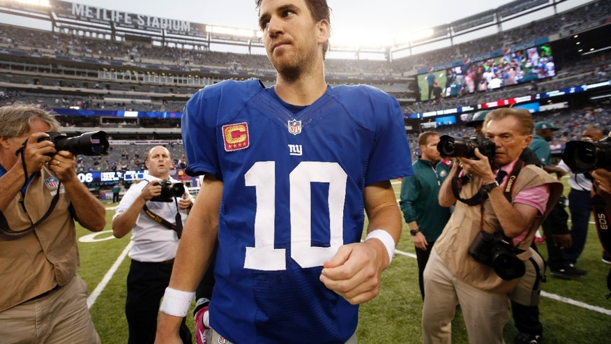 New York Giants' Eli Manning (10) leaves the field after an NFL football game against the Philadelphia Eagles, Sunday, Oct. 6, 2013, in East Rutherford, N.J. The Eagles won 36-21. (AP Photo/Kathy Willens)