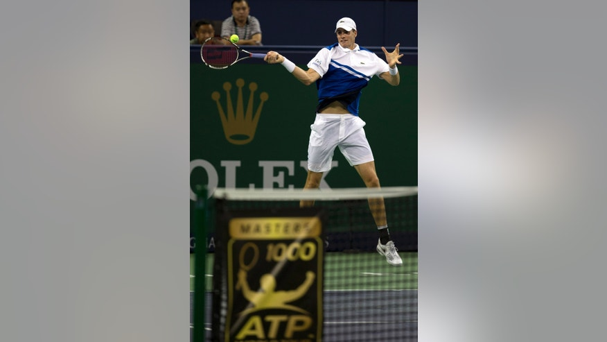 United States' John Isner returns a shot from Colombia's Santiago Giraldo during the first round at the Shanghai Masters Tennis tournament in the Qi Zhong Tennis Center in Shanghai, China on Monday, Oct. 7, 2013. Isner won 4-6, 7-5, 7-5.  (AP Photo/Ng Han Guan)