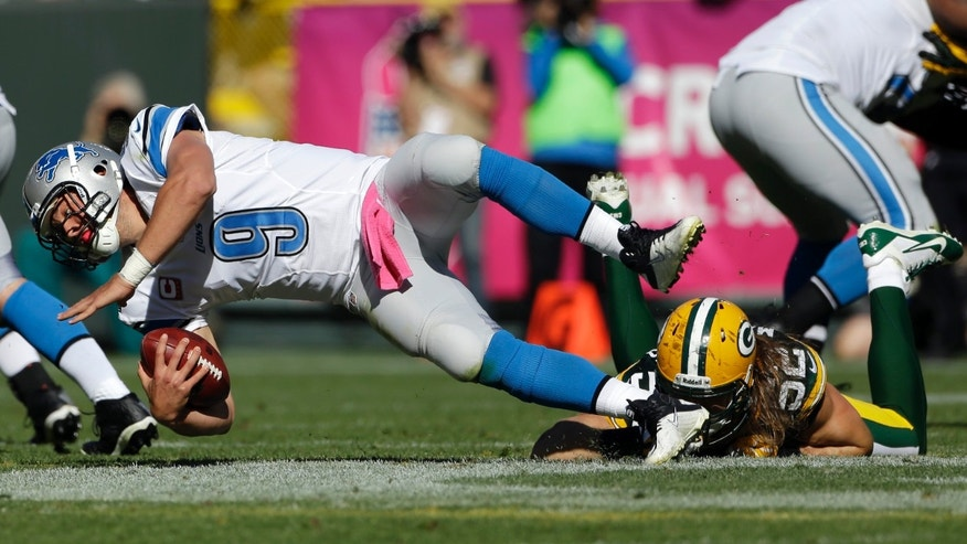Green Bay Packers' Clay Matthews (52) sacks Detroit Lions quarterback Matthew Stafford during the second half of an NFL football game Sunday, Oct. 6, 2013, in Green Bay, Wis. (AP Photo/Morry Gash)