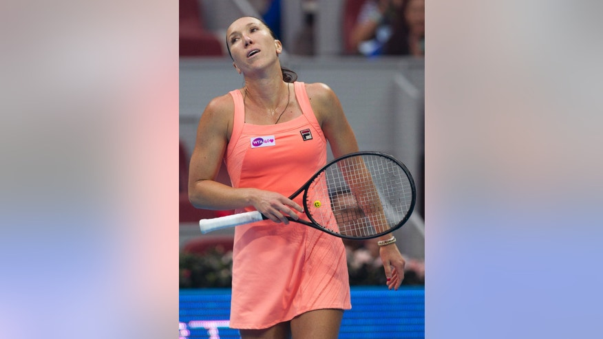 Jelena Jankovic of Serbia reacts after defeating Petra Kvitova of the Czech Republic during the semifinal of the China Open tennis tournament at the National Tennis Stadium in Beijing, China Saturday, Oct. 5, 2013. (AP Photo/Andy Wong)