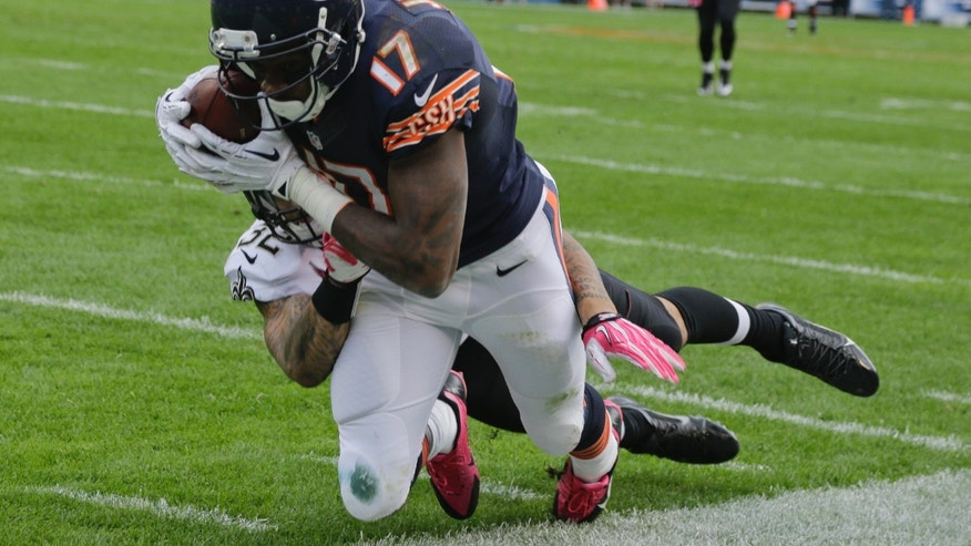 Chicago Bears wide receiver Alshon Jeffery (17) makes a catch against New Orleans Saints strong safety Kenny Vaccaro (32) during the second half of an NFL football game, Sunday, Oct. 6, 2013, in Chicago.(AP Photo/Nam Y. Huh)