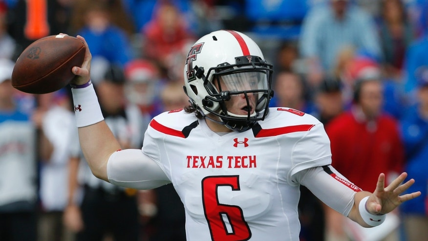 Texas Tech quarterback Baker Mayfield (6) passes to a teammate during the first half of an NCAA college football game against Kansas in Lawrence, Kan., Saturday, Oct. 5, 2013. (AP Photo/Orlin Wagner)