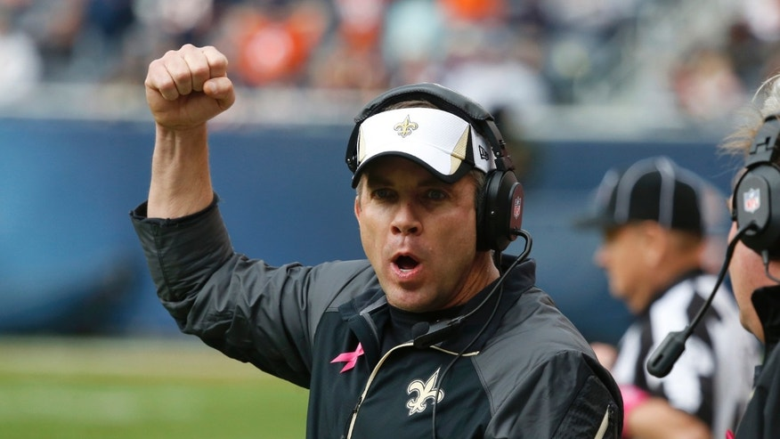 New Orleans Saints head coach Sean Payton reacts to a play during the second half of an NFL football game against the Chicago Bears, Sunday, Oct. 6, 2013, in Chicago. Saints won 26-18. (AP Photo/Charles Rex Arbogast)