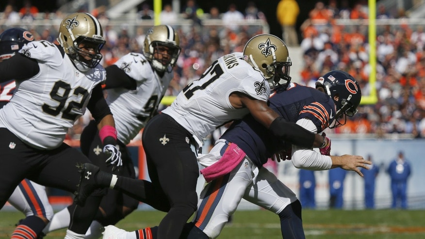 Chicago Bears quarterback Jay Cutler (6) fumbles the ball as New Orleans Saints free safety Malcolm Jenkins (27) tackles him during the first half of an NFL football game, Sunday, Oct. 6, 2013, in Chicago. (AP Photo/Charles Rex Arbogast)