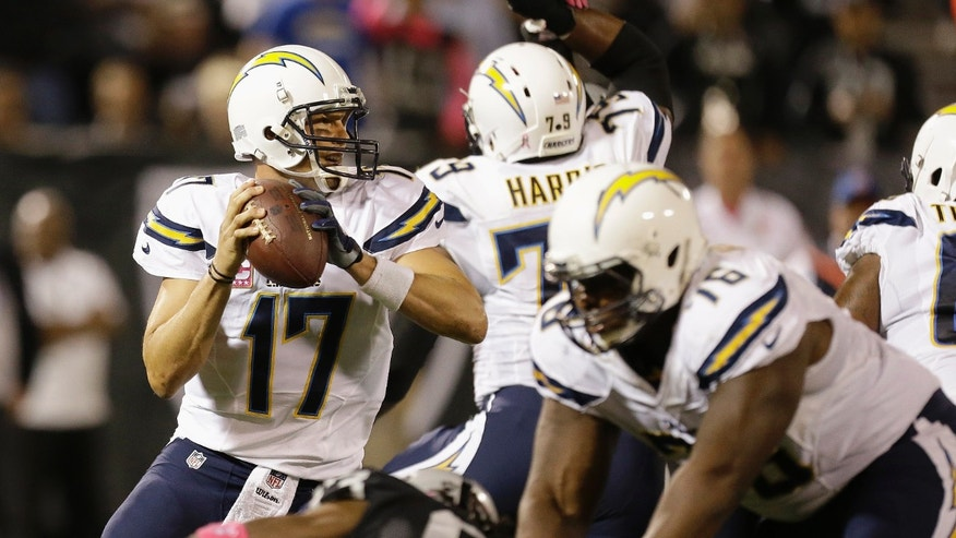 San Diego Chargers quarterback Philip Rivers (17) drops back to pass during the first quarter of an NFL football game against the Oakland Raiders in Oakland, Calif., Sunday, Oct. 6, 2013. (AP Photo/Tony Avelar)