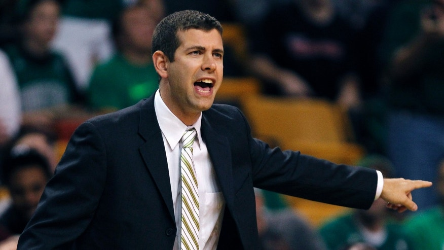 Boston Celtics coach Brad Stevens calls to his players during the first quarter of a preseason NBA basketball game against the Toronto Raptors, Monday, Oct. 7, 2013, in Boston. (AP Photo/Charles Krupa)