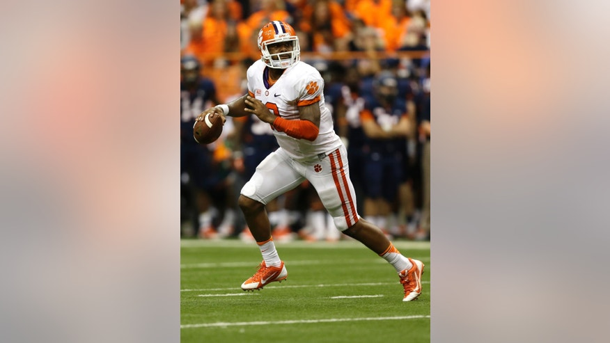 Clemson quarterback Tajh Boyd (10) looks to pass against Syracuse during the first half of an NCAA college football game on Saturday, Oct. 5, 2013, in Syracuse, N.Y. (AP Photo/Mike Groll)