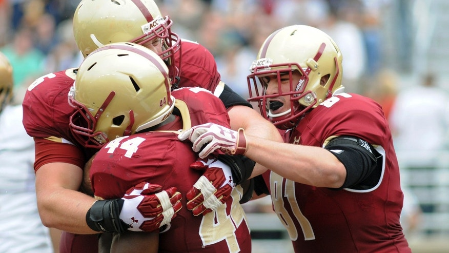 Boston College's Bobby Vardaro, left rear, and Louie Addazio, right, celebrate Andre Williams' touchdown against Army during an NCAA college football game Saturday, Oct. 5, 2013, in Boston. Boston College won 48-27. (AP Photo/The Herald, Faith Ninivaggi) BOSTON GLOBE OUT, METRO BOSTON NEWSPAPER OUT, MAGS OUT, ONLINES OUT