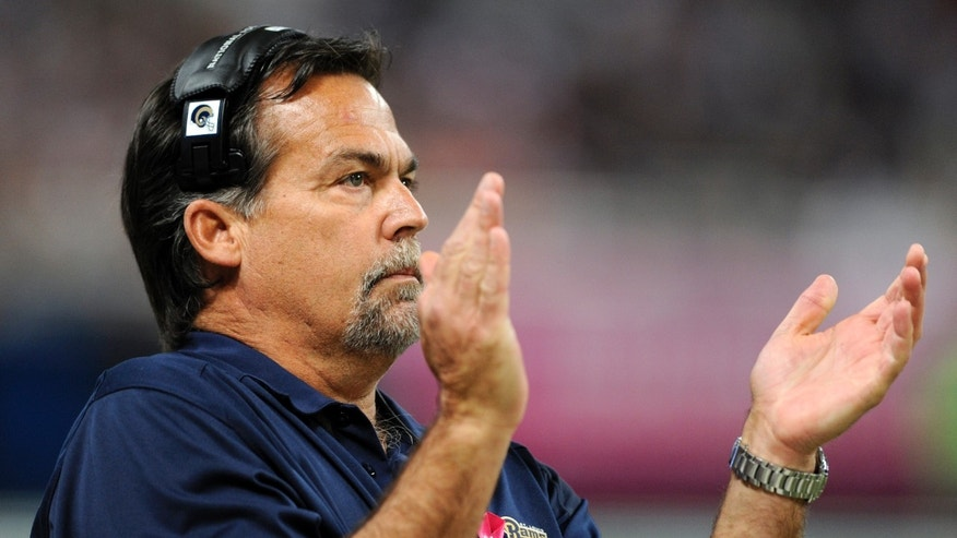 St. Louis Rams head coach Jeff Fisher applauds on the sidelines during the second quarter of an NFL football game against the Jacksonville Jaguars Sunday, Oct. 6, 2013, in St. Louis. (AP Photo/L.G. Patterson)