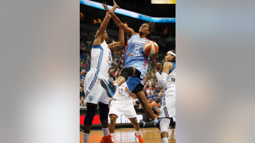 Atlanta Dream guard Tiffany Hayes (14) goes up to the basket past Minnesota Lynx forward Rebekkah Brunson (32) during the first half of Game 2 of the WNBA basketball finals, Tuesday, Oct. 8, 2013, in Minneapolis. (AP Photo/Stacy Bengs)