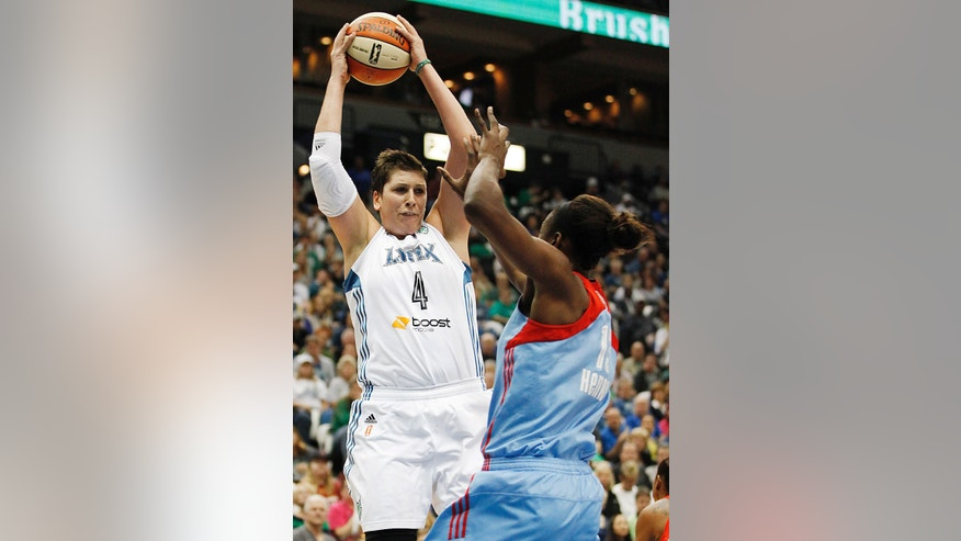 Minnesota Lynx forward Janel McCarville (4) grabs a rebound against Atlanta Dream forward Aneika Henry during Game 2 of the WNBA basketball finals, Tuesday, Oct. 8, 2013, in Minneapolis. (AP Photo/Stacy Bengs)