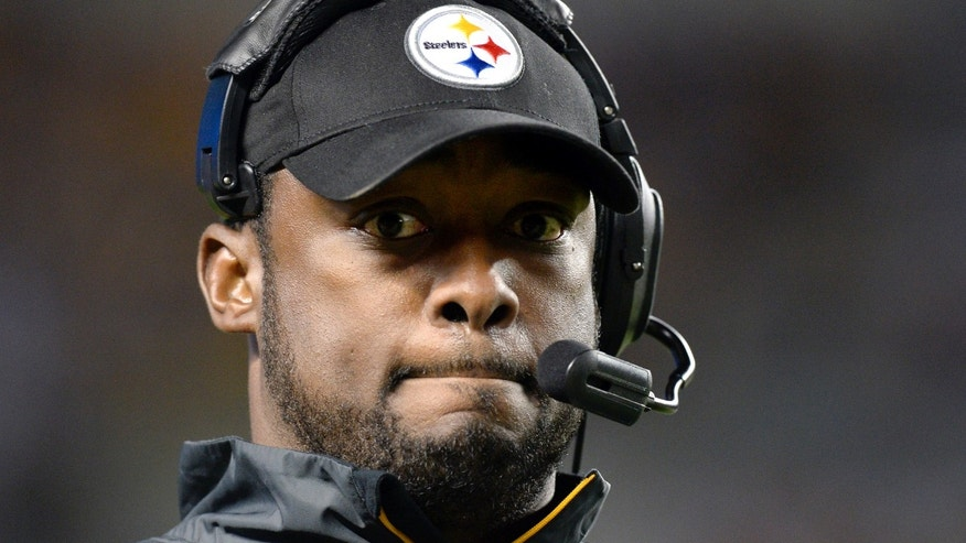 "ADVANCE FOR WEEKEND EDITIONS, OCT. 5-6 - FILE - In this Sept. 22, 2013, file photo, Pittsburgh Steelers head coach Mike Tomlin walks the sideline while his team is losing to the Chicago Bears in the fourth quarter of an NFL football game in Pittsburgh. Tomlin describes himself as a man of ""great patience."" He will need it to endure the franchise's worst start in 45 years. (AP Photo/Don Wright, File)"