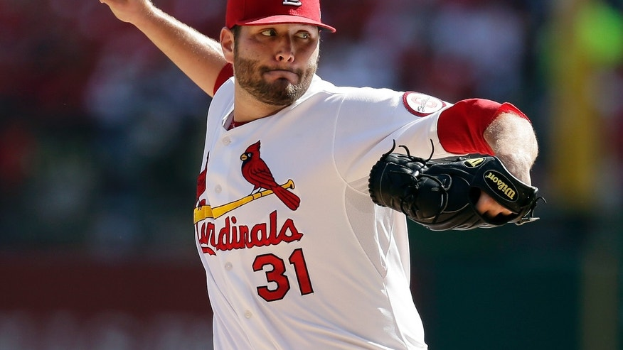 St. Louis Cardinals pitcher Lance Lynn throws against the Pittsburgh Pirates in the first inning of Game 2 of baseball's National League division series on Friday, Oct. 4, 2013, in St. Louis. (AP Photo/Charlie Riedel)