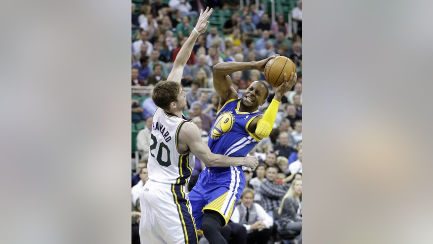 Utah Jazz forward Gordon Hayward (20) defends Golden State Warriors guard Andre Iguodala (9) in the second quarter during an NBA preseason basketball game Tuesday, Oct. 8, 2013, in Salt Lake City. (AP Photo/Rick Bowmer)