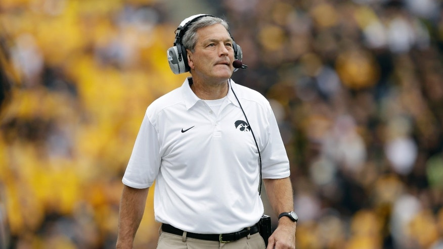 Iowa head coach Kirk Ferentz looks on from the sideline during the first half of an NCAA college football game against Michigan State, Saturday, Oct. 5, 2013, in Iowa City, Iowa. Michigan State won 26-14. (AP Photo/Charlie Neibergall)