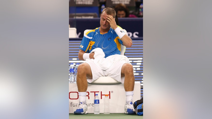Lleyton Hewitt of Australia pauses during the singles match against Andreas Seppi of Italy at the Shanghai Masters tennis tournament at Qizhong Forest Sports City Tennis Center, in Shanghai, China, Tuesday, Oct. 8, 2013. Seppi won 6-4, 6-2. (AP Photo/Eugene Hoshiko)