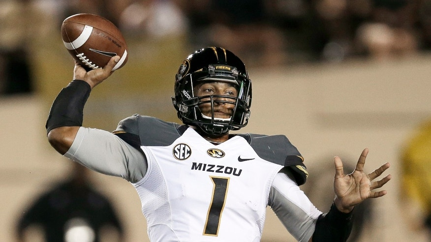 Missouri quarterback James Franklin passes against Vanderbilt in the first quarter of an NCAA college football game on Saturday, Oct. 5, 2013, in Nashville, Tenn. (AP Photo/Mark Humphrey)