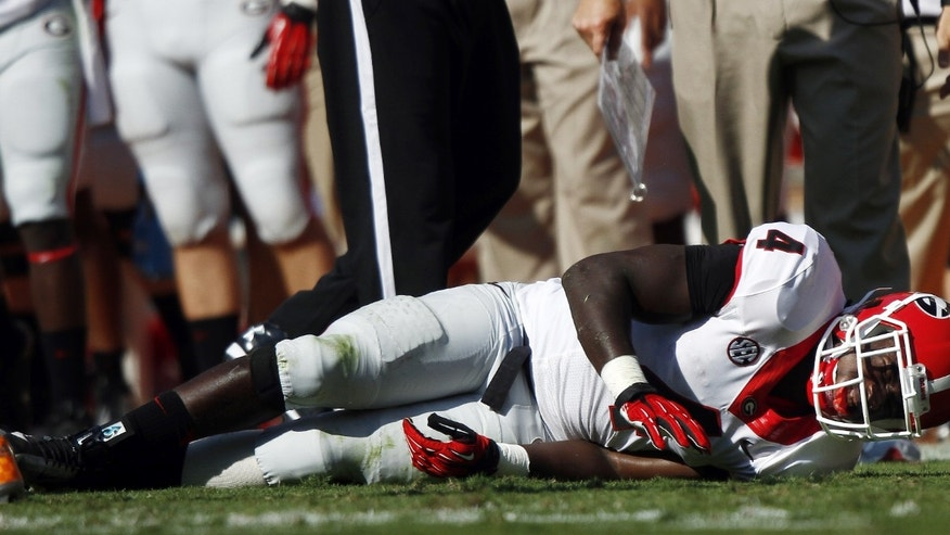 Georgia Keith Marshall (4) lies on the field after being injured in the first quarter of an NCAA college football game against Tennessee on Saturday, Oct. 5, 2013, in Knoxville, Tenn. (AP Photo/Wade Payne)