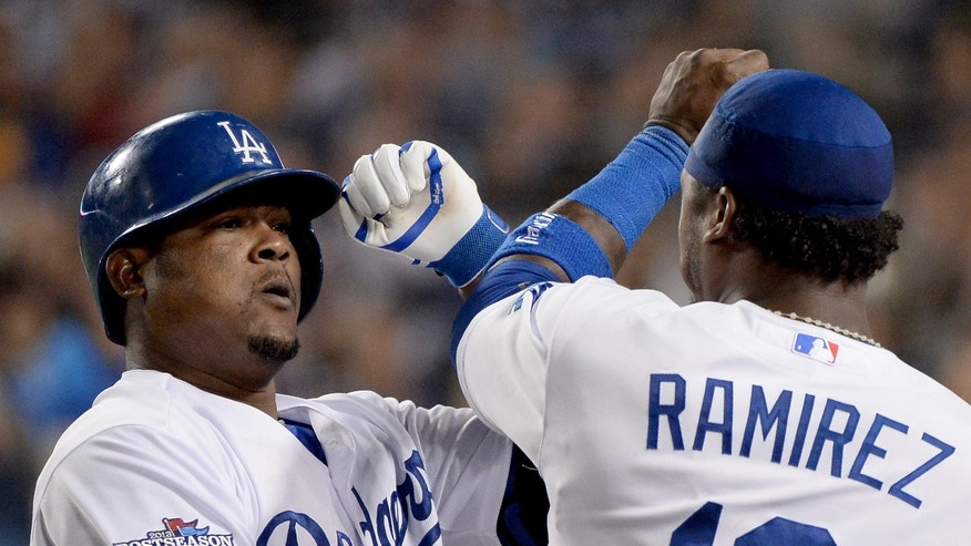 Juan Uribe celebrates with Hanley Ramirez after hitting a two-run home run in the eighth inning against the Atlanta Braves on October 7, 2013.