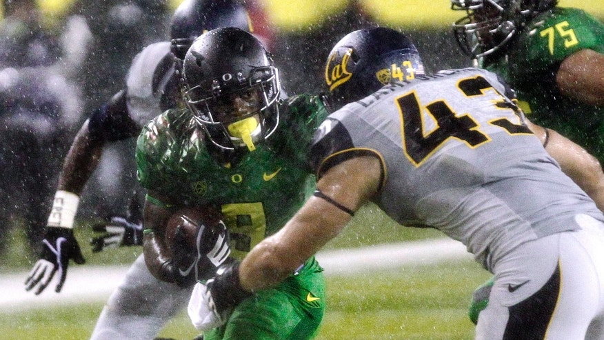 "FILE - In this Sept. 28, 2013, file photo, Oregon running back Byron Marshall, left, tries to evade California defender Dan Camporeale during the first half of an NCAA college football game in Eugene, Ore. Marshall embodies Oregon's ""Next Man In"" philosophy. Called on last weekend against Cal when De'Anthony Thomas hurt his ankle, he ran for 130 yards and two touchdowns. He'll be called again Saturday when the No. 2 Ducks visit Colorado (AP Photo/Don Ryan, File)"