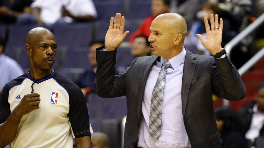 Brooklyn Nets head coach Jason Kidd, right, talks with referee Tom Washington in the first half of an NBA preseason basketball game against the Washington Wizards, Tuesday, Oct. 8, 2013, in Washington. (AP Photo/Alex Brandon)
