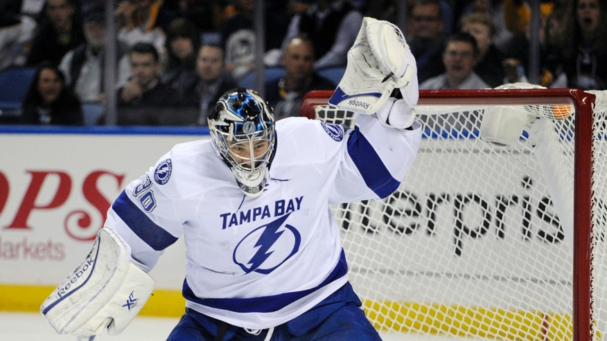 Tampa Bay Lightning goaltender Ben Bishop makes a glove save against the Buffalo Sabres during the first period of an NHL hockey game in Buffalo, N.Y., Tuesday, Oct. 8, 2013. (AP Photo/Gary Wiepert)