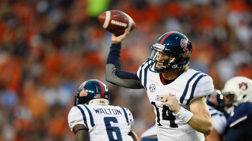 Mississippi quarterback Bo Wallace throws against Auburn in the first half of an NCAA college football game on Saturday, Oct. 5, 2013, in Auburn, Ala. (AP Photo/Todd J. Van Emst)
