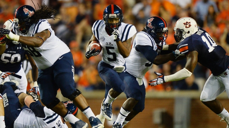 Mississippi's I'Tavius Mathers runs against Auburn in the first half of an NCAA college football game on Saturday, Oct. 5, 2013, in Auburn, Ala. (AP Photo/Todd J. Van Emst)