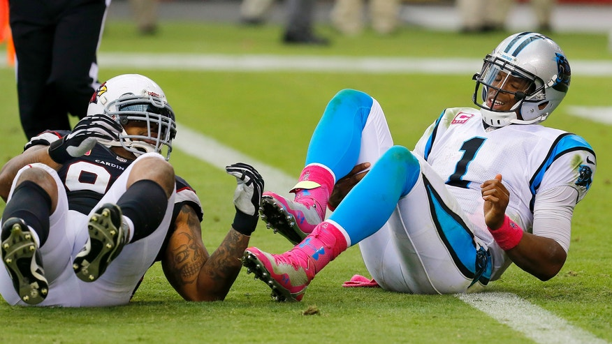 Carolina Panthers' Cam Newton (1) gets up slowly after being hit by Arizona Cardinals' Darnell Dockett in the second half of an NFL football game on Sunday, Oct. 6, 2013, in Glendale, Ariz.  The Cardinals defeated the Panthers 22-6. (AP Photo/Ross D. Franklin)
