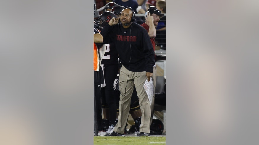 Stanford head coach David Shaw gestures during the first half of an NCAA college football game against Washington in Stanford, Calif., Saturday, Oct. 5, 2013. (AP Photo/George Nikitin)