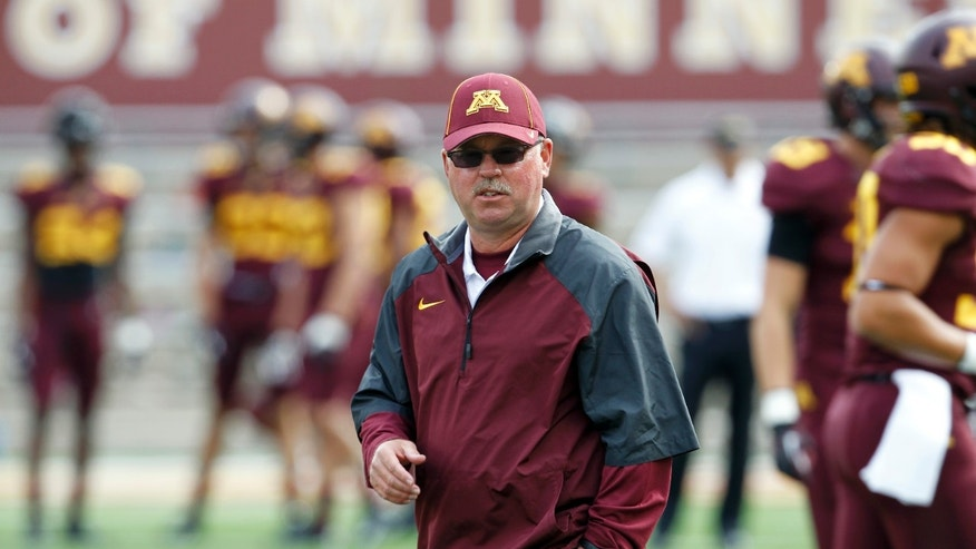 FILE - In this Sept. 21, 2013, file photo, Minnesota head coach Jerry Kill watches his team prior to an NCAA college football game against San Jose State in Minneapolis. Kill has suffered another seizure and did not make the trip with the Golden Gophers to face No. 19 Michigan on Saturday, Oct. 5, 2013.  (AP Photo/Ann Heisenfelt, File)