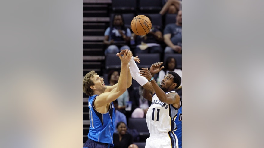 Memphis Grizzlies' Mike Conley (11) and Dallas Mavericks' Dirk Nowitzki, left, go for a rebound during the first half of an NBA preseason basketball game in Memphis, Tenn., Wednesday, Oct. 9, 2013. (AP Photo/Danny Johnston)