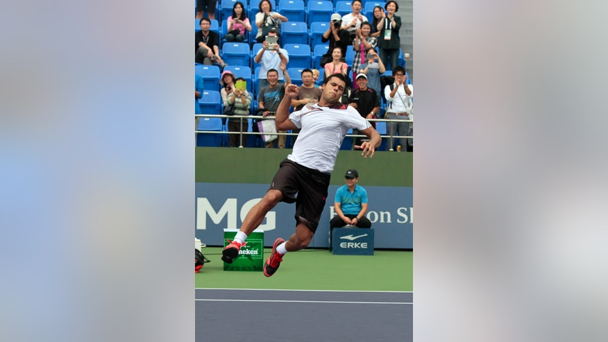 Jo-Wilfried Tsonga of France jumps in celebration after defeating Pablo Andujar of Spain in their singles match at the Shanghai Masters tennis tournament at Qizhong Forest Sports City Tennis Center, in Shanghai, China, Wednesday, Oct. 9, 2013. (AP Photo/Eugene Hoshiko)