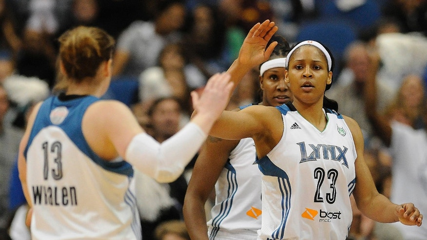 Minnesota Lynx forward Maya Moore (23) high fives teammate guard Lindsay Whalen (13) during the second half of Game 2 of the WNBA basketball finals against the Atlanta Dream, Tuesday, Oct. 8, 2013, in Minneapolis. The Lynx won 88-63. (AP Photo/Stacy Bengs)