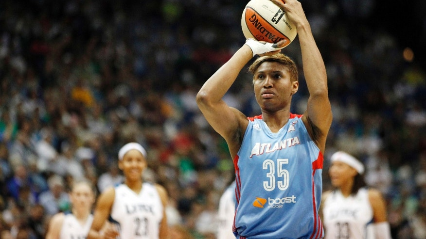 Atlanta Dream guard Angel McCoughtry (35) shoots the ball after a technical foul during the first half of Game 2 of the WNBA basketball finals against the Minnesota Lynx, Tuesday, Oct. 8, 2013, in Minneapolis. (AP Photo/Stacy Bengs)