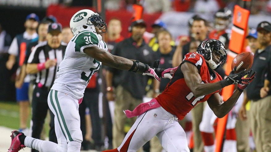 Atlanta Falcons wide receiver Julio Jones can't hold on to a pass as he is hit by New York Jets cornerback Antonio Cromartie during the second half of an NFL football game Monday, Oct. 7, 2013, in Atlanta. (AP photo/Atlanta Journal Constitution, Curtis Compton) GWINNETT OUT  MARIETTA OUT  LOCAL TV OUT (WXIA, WGCL, FOX 5)