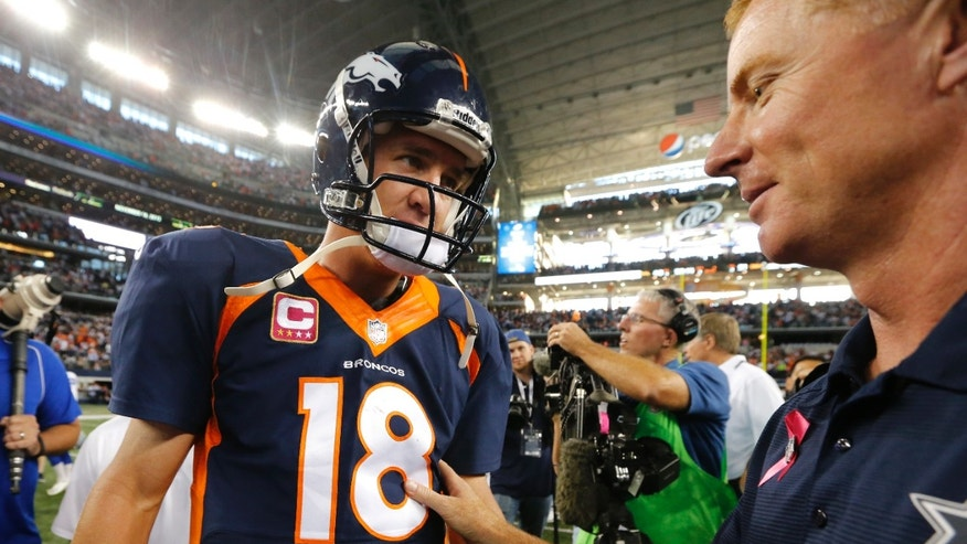 Denver Broncos quarterback Peyton Manning (18) greets Dallas Cowboys head coach Jason Garrett after an NFL football game Sunday, Oct. 6, 2013, in Arlington, Texas. Denver won 51-48. (AP Photo/Sharon Ellman)