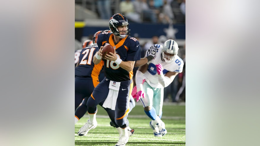 Denver Broncos quarterback Peyton Manning (18) looking for receivers during the second half of an NFL football game against the Dallas Cowboys Sunday, Oct. 6, 2013, in Arlington, Texas. The Broncos won 51-48. (AP Photo/Waco Tribune Herald, Jose Yau)