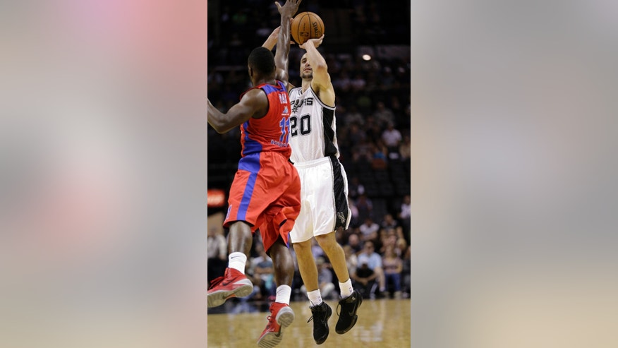 San Antonio Spurs' Manu Ginobili (20), of Argentina, shoots over CSKA Moscow's Jeremy Pargo during the first half of an exhibition NBA basketball game, Wednesday, Oct. 9, 2013, in San Antonio. (AP Photo/Eric Gay)