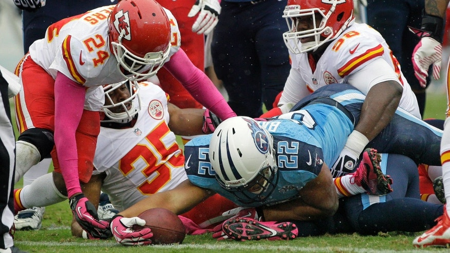Tennessee Titans running back Jackie Battle (22) is stopped at the 1-yard line by Kansas City Chiefs defenders Quintin Demps (35), Brandon Flowers (24) and Anthony Toribio (98) on fourth down in the second quarter of an NFL football game on Sunday, Oct. 6, 2013, in Nashville, Tenn. (AP Photo/Wade Payne)