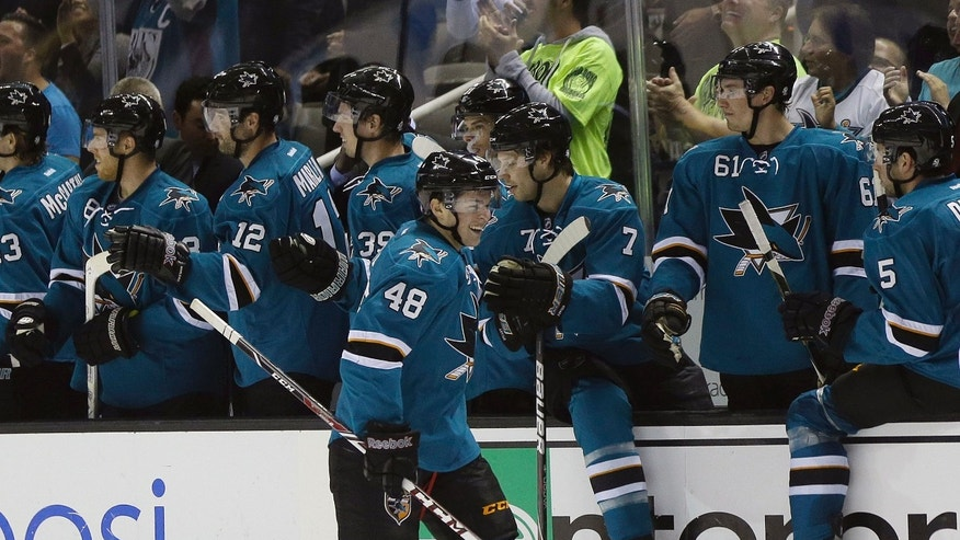 San Jose Sharks' Tomas Hertl (48) celebrates with teammates on the bench after scoring against the New York Rangers during the second period of an NHL hockey game on Tuesday, Oct. 8, 2013, in San Jose, Calif. (AP Photo/Marcio Jose Sanchez)