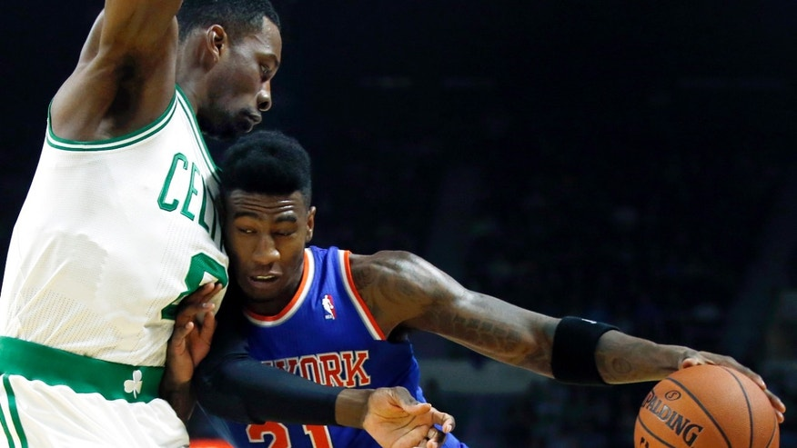 New York Knicks guard Iman Shumpert (21) drives against Boston Celtics forward Jeff Green during the first half of a preseason NBA basketball game in Providence, R.I., Wednesday, Oct. 9, 2013. (AP Photo/Elise Amendola)
