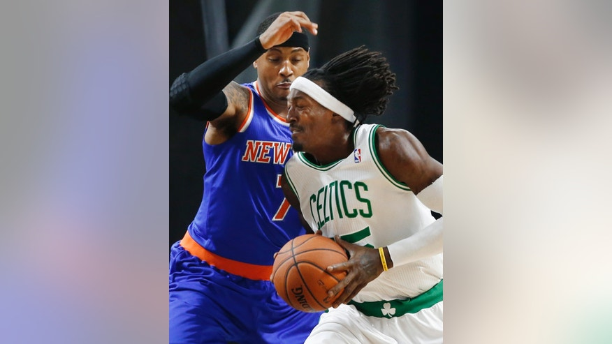 Boston Celtics forward Gerald Wallace drives against New York Knicks forward Carmelo Anthony (7) during the first half of a preseason NBA basketball game in Providence, R.I., Wednesday, Oct. 9, 2013. (AP Photo/Elise Amendola)