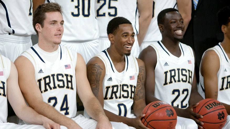 Notre Dame players Pat Connaughton, left, Eric Atkins, middle, and Jerian Grant pose for the squad's official photograph during the NCAA college basketball team's media day, Wednesday, Oct. 9, 2013, in South Bend, Ind. (AP Photo/South Bend Tribune, James Brosher)